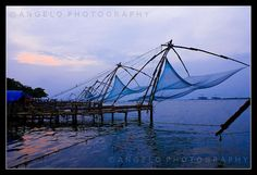 The Chinese fishing nets (Cheena vala) of Fort Kochi in the City of Kochi (Cochin), in Kerala, are fixed land installations for an unusual form of fishing — shore operated lift nets. Huge mechanical contrivances hold out horizontal nets of 20 m or mo #fishing  Click the on the pic for more info.  http://www.bamboonets.com