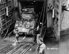 2nd_Armored_Division_M4_Sherman_Debarks_LST_Normandy_June_44.jpg