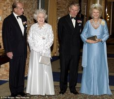 Prince Philip, Queen Elizabeth II, Prince Charles and Camilla Duchess of Cornwall...I can't tell if Prince Phillip looks respectful or shocked at Camilla's victory smile...