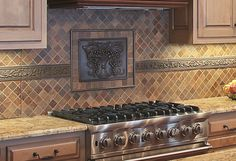 This backsplash features an Elon metal decorative tile and travertine tile laid on the diagonal. Home built by Martin Bros. Contracting.