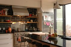 a convivial kitchen space, full of life! By Cuisines Steam