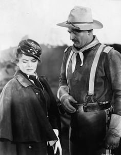 Still of John Wayne and Joanne Dru in She Wore a Yellow Ribbon (1949)