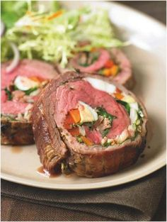 This dish is as pleasing for the eyes as it sounds for your taste buds!     Argentine Stuffed Flank Steak