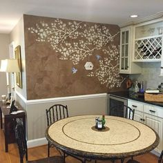 A DIY stenciled kitchen accent wall using the Japanese Maple Branch Stencil from Cutting Edge Stencils. http://www.cuttingedgestencils.com/branch-stencil.html
