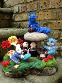 Needle felted Alice in Wonderland. I love this so much! So very talented.