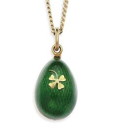 FABERGE - a contemporary green enamelled egg form pendant with chain   the ovoid pendant decorated with bright green guilloche enamel highlighted in gilt to one side with a four-leaf clover, signed and numbered 615/1000, also stamped 750, suspended from a flattened curb link chain  Lengths: pendant 2.5cm, chain 45cm.