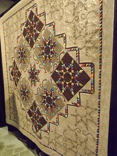 .many photos of outstanding quilts