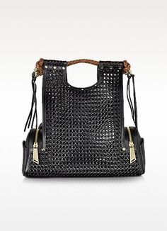 €1390.00 | Priscilla New Black Bentota Tote Bag crafted in supple Teflon coated open-weave eco-leather with leather accents, is the perfect bag for an uptown funky chic vibe. Featuring handmade woven leather handles with tassels, metal rivet details, detachable adjustable strap, two outer zip side pockets with perforated logo detail on slip pocket, interior zipper pouch with signature polished steel portable mirror and 24K gold plated brass hardware detail. Made in Italy.
