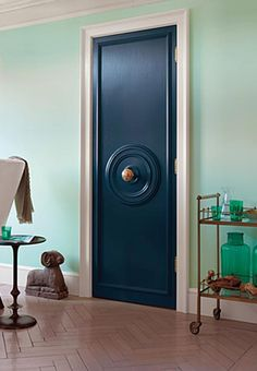"""""""One ceiling medallion and some hardware later, you have a formerly blah door that looks super custom and expensive"""""""