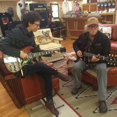 Sarah Lee Gutherie and dad Arlo Gutherie, trying out a couple of SG's. 11.13.15 taken by Johnny Irion, her husband