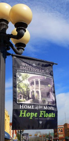 Smithville_Texas_Banner - flies on Main Street and alternates with other banners. franLan multimedia created the flag design. Smithville Texas, Hope Floats, Moving To Texas, Film Movie, Movies, Flag Design, Street Signs, Oh The Places You'll Go, Main Street
