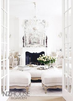 obsessed - french perfection - with french doors flung open, silk carpets and linen ottomans, carved consoles, venetian glass mirrors and chandeliers, and of course, late-summer whites . . .