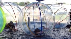 """In this image released by the Consumer Product Safety Commission children play in water walking balls. The government is warning people not to use those giant see-through inflatable spheres known as """"water walking balls"""" because of the risk of suffocation or drowning. (AP Photo/CPSC)"""
