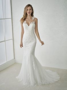 FELICIA  Sophisticated and sensual mermaid wedding dress with an illusion V-neck and back. The embroidered crystal tulle lace appliqués and beading create a very sexy second-skin effect. A dress in embroidered tulle and lace that plays with illusions to accentuate femininity. http://www.sanpatrick.com/ro/wedding-dresses/felcia-illusions.html  FELICIA