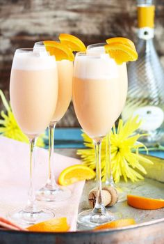 Pineapple Juice, orange sherbert and sparkling moscato are blended together for the ultimate brunch cocktail.: