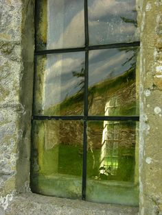 Window Reflections by Giles C. Watson on Flickr.