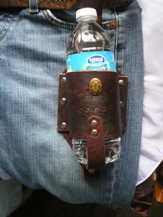 Hand cut  leather  beer bottle  holder   with snap  loop  to clip on your belt  hand stamped and decorated  in  Brown. $23.99, via Etsy.best fathers day gift idea!!