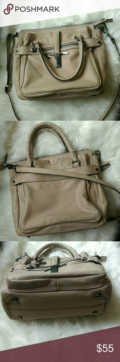 Elliot Luca leather handbag This is an awesome light taupe colored handbag. It has a removable strap so it can be a crossbody. Great for travel, that was what I used it for. It is in EUC, minimal wear to the outsite, inside looks brand new. Some of the metal accents show wear and there is some very slight discoloration on the handle. It is 100% leather body and 100% polyester lining. Only reason I'm selling this is it's not really my style anymore and I have one too many handbags. Reasonable…