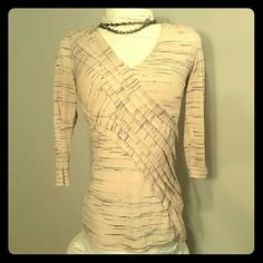 Anthropologie Deletta Top NWOT 😀HP😀 Cream with black streaked 3/4 sleeve top by Anthropologie Deletta is fitted with a pleated sash running diagonally giving it a faux wrap look with a slightly asymmetric cut.  Never worn. Anthropologie Tops