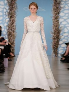 384c0f65d6b6 Oscar de la Renta Bridal 2014 - Ivory silk faille sweetheart gown with  ivory floral corded Chantilly lace overlay.