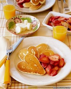 Heart pancakes you can make by pouring batter into plastic bag and squeezing out the desired design! Very romantic. LOVE