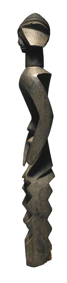 "Mumuye Male Figure, Nigeria | Lot | Sotheby's - ""[...] these unique works, which are so admired today, did not reach Western museum and the international art market until the end of the 1960s, with the exception of two sculptures acquired by the British Museum in 1922. As regards function, we only know that the figures were stored in special houses and were used by diviners, healers, judges, blacksmiths, and rainmakers in ceremonial contexts. Some of them also served as family guardian…"