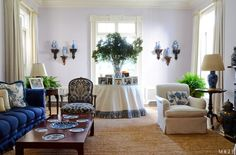 Aerin Lauder's living room in her East Hampton home. Cheery and classic simplicity, lavender walls, white moldings