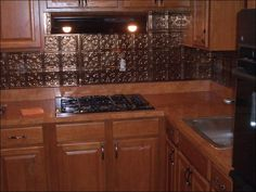 Kitchen, Magnificent Kitchen Design Beautified With Metal Kitchen Backsplash Designed In Classic Pattern Coupled With Marvelous Brown Granit...