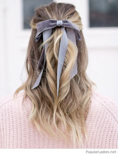 Brown and blonde hair color with a navy hair bow