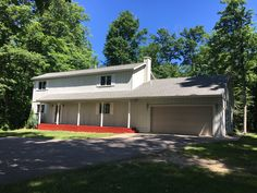 Another Leelanau County Beauty. This 2 story cape cod sits on a private wooded lot and like most homes in the area it is less than 5 minutes to Lake Leelanau. Lake Leelanau, Traverse City, Cape Cod, Shed, Floor Plans, Real Estate, Outdoor Structures, Homes, Flooring