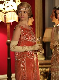 Lily James as Lady Rose MacClare inDownton Abbey Series 4 Christmas Special (2013).