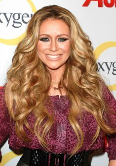 "Do you like Aubrey O""Day better with blonde or red hair? Answer my poll on Buzznet!"