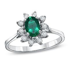 Oval Emerald and 1/7 CT. T.W. Diamond Frame Ring in 14K White Gold
