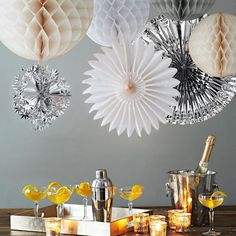 Party in a Box - West Elm - Each box includes: 5 paper balls, 2 paper fans, 6 champagne coupes, a stainless steel cocktail shaker, a lacquered serving tray, 6 votive holders and confetti.