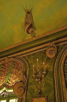 ceramic snails climb the walls of the ornano family's flat in paris