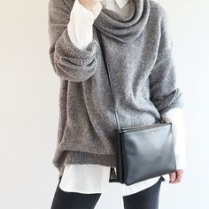 slouchy sweater over buttoned down shirt.  shoulder bag.  gray, white and black.