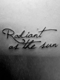 """These words come from an early section in the book when Katniss describes herself. The entire quote reads: """"I am not pretty. I am not beautiful. I am as radiant as the sun."""" This tattoo belongs to Claire McDonald of Huntsville, Alabama. The original source is on her blog:  http://tinyteacuptempest.tumblr.com/post/3650637508"""