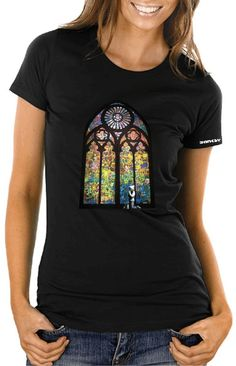 Banksy Stained Glass Window T-shirt – Women's Slim-fit – £15    http://banksyt-shirts.com/banksy-stained-glass-window-t-shirt-womens-slim-fit/    This summer Banksy contributed to the first US museum graffiti and streetart exhibition at MOCA.    This 23ft high stained glass window was the main attraction to Banksy's work. It was made in collab with the City Of Angels school in LA. They we're asked to 'tag' their name of panels of wood and then Banksy used them to form this magnificent piece!