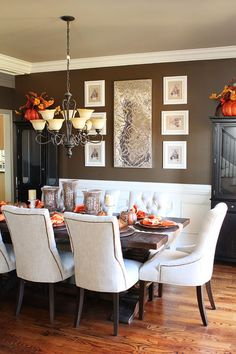 Dining Room. White wainscoting on the bottom and dark paint color on the top.