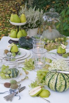.must purchase glass cloche.   Tablescape uses my faves.