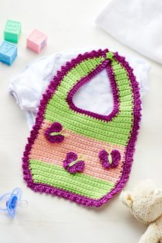Lynne Rowe's butterfly bib is the perfect gift for expecting parents — just swap the pink for a blue if you're making for a boy or opt for a white if you're unsure. Worked in simple double crochet, Crochet Baby Bibs, Bag Crochet, Crochet Gratis, Crochet Baby Clothes, Crochet For Kids, Free Crochet, Knitting Patterns Free, Free Knitting, Baby Knitting