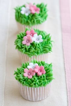 Photo about Mini cupcakes decorated with frosted grass and pink flowers. Image of baking, decorated, cupcakes - 12591477 Garden Cupcakes, Spring Cupcakes, Easter Cupcakes, Flower Cupcakes, Fun Cupcakes, Cupcake Cookies, Mothers Day Cupcakes, Mocha Cupcakes, Banana Cupcakes