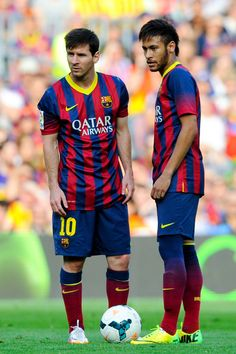 Lionel Messi (L) and Neymar of FC Barcelona look on during the La Liga match between FC Barcelona and Club Atletico de Madrid at Camp Nou on May 17, 2014 in Barcelona, Catalonia.