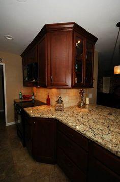 StarMark maple chestnut cabinets with Cambria Bradshaw.