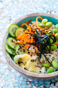 Spicy Veggie Sushi Bowls - Like your favorite sushi roll, but in a bowl! Served over brown rice with a spicy sriracha mayo.