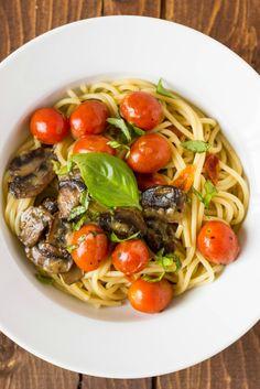 Caramelized Mushrooms, Roasted Garlic, and Cherry Tomato Pasta {Via @thecookiewriter}
