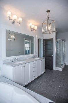 White Bathroom Ideas, Polished Nickel Fixtures, Grey Marble Bath Surround And Countertops, And Dark Tile Floors