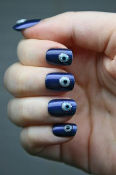 Keep evil away while having extra cool nails with this Evil Eye nail art! I like how it doesn't look cartoony but like an actual Evil Eye you would find in the middle east.