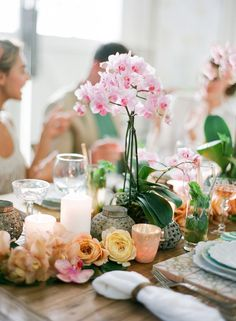 Orchids and candles as runner on table