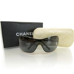 100 % Authentic CHANEL sunglasses Beautiful CHANEL sunglasses w a pearl... Great condition. No flaws no scratches. Worn only a handful of times. Bought at Neiman Marcus. Very classy... Paid $685 because of the real pearls on the side. CHANEL Accessories Sunglasses